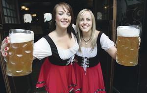 Two barmaids serve up beers at an Octoberfest event in Belfast