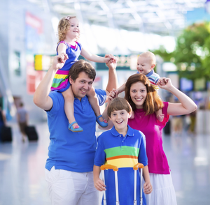 Families face a premium price for mid-term flights (picture posed)