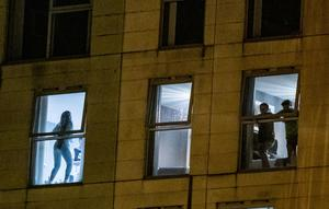 Revellers at the Obel Tower 64 apartment complex at the weekend