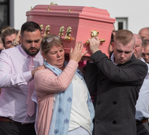 Tragedy: The pink coffin of road accident victim Kelsey Marie Stokes (3) at St Joseph's Church in Galliagh, Londonderry
