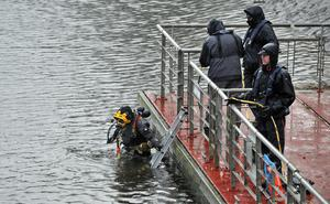 Divers search the River Lagan close to the Stranmillis Embankment in Belfast two weeks ago after reports of a body in the water
