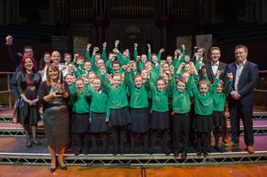 St Patrick's Primary School won the junior category. The kids are seen with guest judge Carrie Grant (left), presenters John Toal and Kerry McLean, other judges, and their teachers