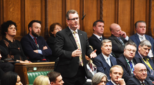 The DUP's Sir Jeffrey Donaldson addresses the House with Claire Hanna and Colum Eastwood behind him and Stephen Farry to his left
