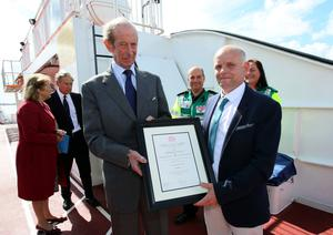 Strangford ferry crew member John Nixon is presented with a Royal Humane Society commendation for bravery