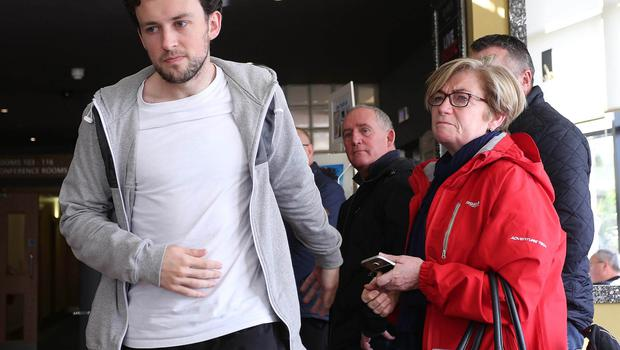 Shocked players attend the Derry City FC Press conference following the sudden death of their club captain Ryan McBride