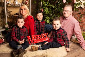 Alfie Pentony with his mum Colleen, dad Jamie and brothers Lucas and Jamie