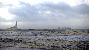 St Mary's Lighthouse surrounded by rough seas in Whitley Bay