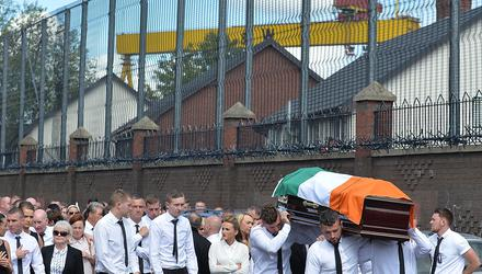Mourners: The funeral of Kevin McGuigan who was murdered by the IRA