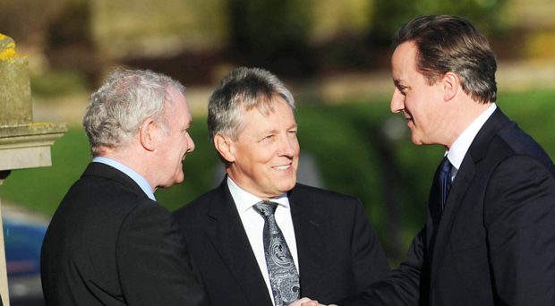 Former PM David Cameron with Martin McGuinness and Peter Robinson
