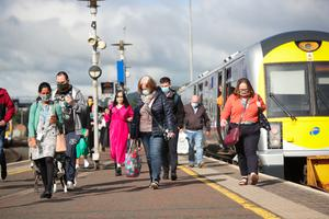 Passengers get off the train at Great Victoria Street
