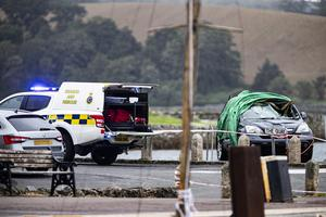 A vehicle is pulled from the waters of Strangford Lough yesterday