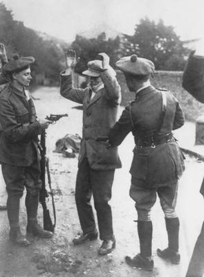 A suspect is searched by temporary constables of the Black and Tans during the Irish War of Independence in 1920