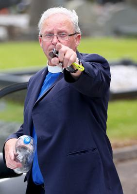 An angry Rev Tom Conway throws water at our photographer Kevin Scott