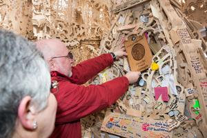 Philippa's parents place the plaque in the Temple yesterday