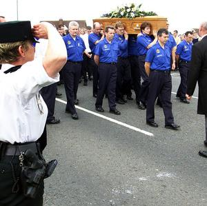The coffin of Gavin Brett is carried by family and friends at his 2001 funeral in Belfast