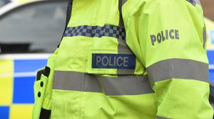 Police have seized a cache of suspected heroin and arrested two men on suspicion of drug trafficking and money laundering offences