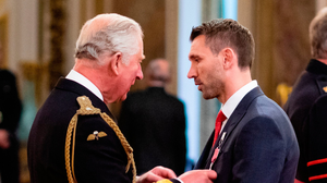 Gareth McAuley is made an MBE by the Prince of Wales at Buckingham Palace
