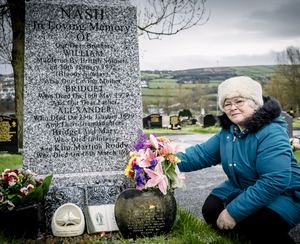 Kate Nash tends to the grave of her brother William