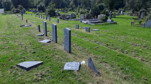 The gravestones were damaged some time between 7pm on Monday and 1pm on Tuesday, police said (PSNI/PA)