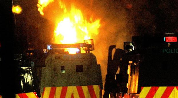 Police have blamed loyalists for violence that erupted in Larne, Co Antrim