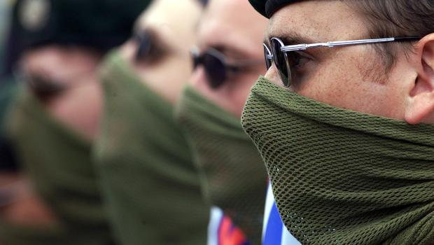 Masked Ulster Freedom Fighters (Ulster Freedom Fighters) men. (PA Archive)