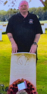 Andy Godfrey stands next to the grave of a First World War soldier