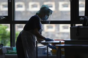 A nurse disinfects work surfaces at the Mater Hospital Covid-19 recovery ward in Belfast (Niall Carson/PA)