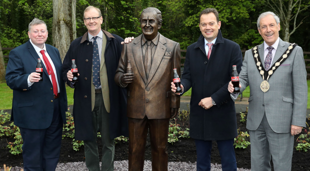 At the unveiling of the statue of Terence Robinson were (from left) Tim Robinson, Paul Porter, Matthieu Seguin of Coca-Cola and Lisburn and Castlereagh mayor Uel Mackin