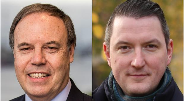 DUP deputy leader Nigel Dodds (left) is facing a strong challenge from Sinn Fein candidate John Finucane in the race for North Belfast (PA)