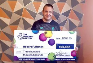 Robert Fullerton (30) celebrates his £300,000 win on a National Lottery Scratchcard