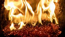 Pellets burning inside a biomass boiler which was purchased with the aid of the Northern Irish version of the Renewable Heat Incentive (Liam McBurney/PA)