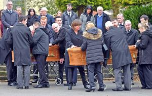 The coffins of Mary and Kevin Faxton leave St Peter and St Paul's in Bessbrook
