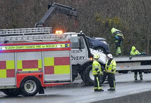 Firefighters at the scene of the accident where three people from Newry were killed