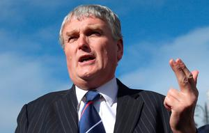 Veteran DUP politician Jim Wells is standing by his decision to quit the National Trust over its support for gay rights