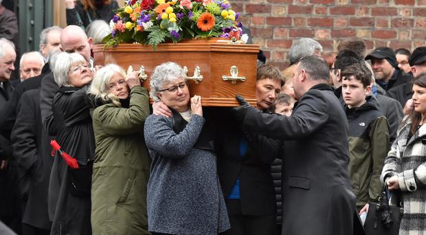 Friends and family pay their respects to poet Padraic Fiacc at St Malachy's Church in Belfast