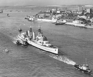 HMS Belfast is towed on her last voyage from Portsmouth Dockyard to her new berth in London as a floating museum in September 1971.