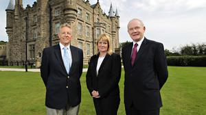 First Minister Peter Robinson (left) and Deputy First Minister Martin McGuinness with former victims' commissioner Kathryn Stone