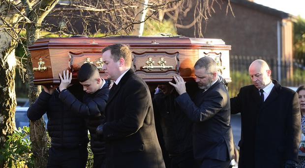 Pallbearers carry the coffin at the funeral of Joe Dutton in west Belfast