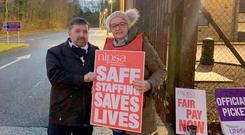 Robin Swann meeting an NHS worker on the picket line last month