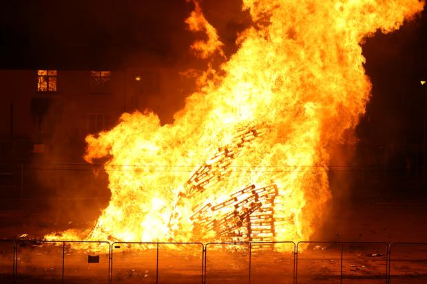 A large bonfire burns to mark the Catholic Feast of the Assumption in the Bogside area of Londonderry (Liam McBurney/PA)