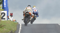 Competitors Bruce Anstey and Guy Martin racing at the Ulster Grand Prix near the site of the proposed cemetery