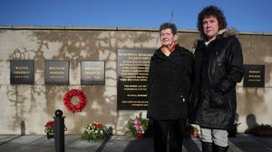 Beatrice Worton (left), mother of Kingsmill victim Kenneth Worton, and his daughter Racquel Brush, attend a roadside service marking the 42nd anniversary of the shooting dead of 10 Protestant workmen by republicans at Kingsmill in South Armagh