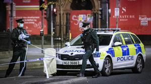 Horror: Police at the scene of a stabbing in the Donegall Square West area of Belfast