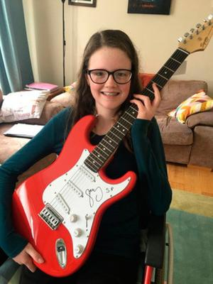 On song: Ayva Hennessy with the guitar for auction donated by Gary Lightbody