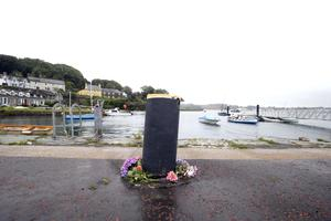 Flowers left at Strangford harbour, where the UTV presenter's car plunged into the waters of the lough