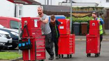 Hundreds of Wrightbus workers leave the factory in Ballymena yesterday