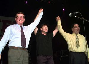 U2 star Bono is flanked by David Trimble and John Hume on stage during a special concert in Belfast to promote the 'Yes' vote in the referendum on the Good Friday Agreement (Chris Bacon/PA)