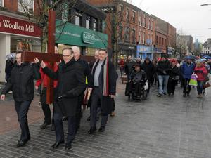 Presbyterian Moderator Rt Rev Dr Noble McNeely (front right) with clergy at the Good Friday Walk of Witness in Lisburn