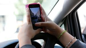 Drivers using mobile phones face tougher penalties (PA)