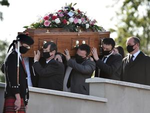 Devastating: Rachel Lowry's coffin is carried during her funeral